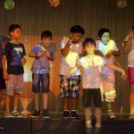 Spettacolo finale del corso estivo per bambini di origine