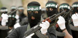 Terroristi a volto coperto(foto La voce del Trentino)